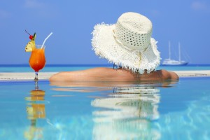 Close-up of a rear view woman into the swimming pool on Maldivian resort.